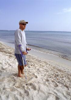 Man with crooks at beach - PE00144
