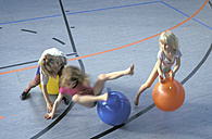 Girls jumping on rubber balls - 00454CR