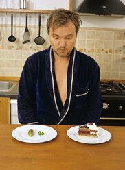 Mature man in kitchen - PE00206