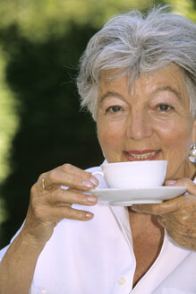 Senior woman drinking coffee, close-up - PEF00330