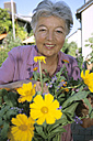 Senior woman working in her garden - PEF00321