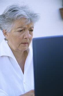 Senior woman using laptop - PEF00318
