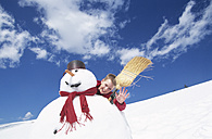 Boy behind snowman with broom - HHF00047