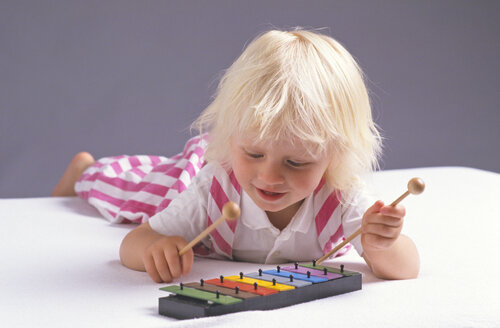 Little child trying to play xylophone - CRF00567