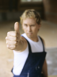 Young craftsman giving thumbs up - PEF00352