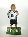 Boy (8-11) holding football on pitch - LMF00017