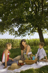 Mother with daughter and son at picnic - CKF00128