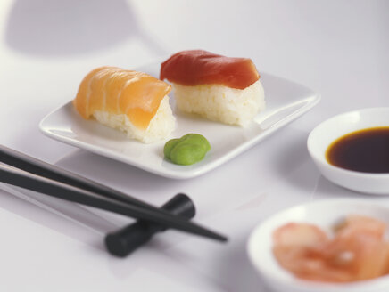 Sushi on plate with chopsticks - THF00024