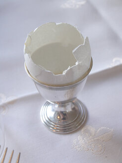 Empty eggshell in silver eggcup - THF00082