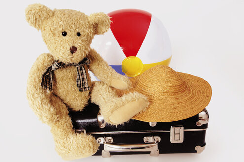 Teddy bear on suit case with hat and ball - 00011LRH-U