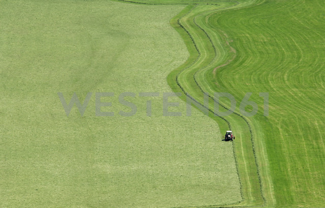 Tractor on meadow, elevated view - HHF00274