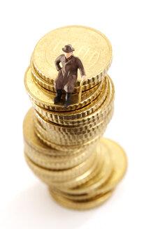 Figurine, old man, sitting on pile of coins - 03135CS-U