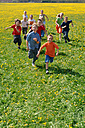 Children (8-13) running on meadow - CR00867