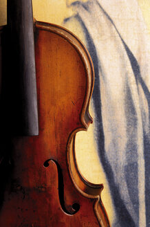 Old violin against painted drapery - 00022LR-U
