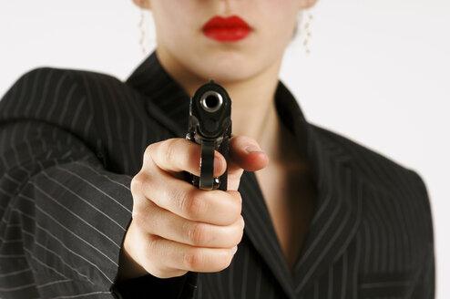 Woman aiming with pistol - 00004LR-U