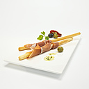Crostini, parma ham around grissini, close-up - WESTF00375