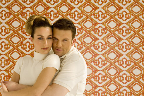 Young couple against wall paper, portrait - WESTF00328