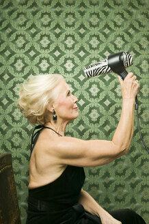 Senior woman with hair-dryer - WEST00360