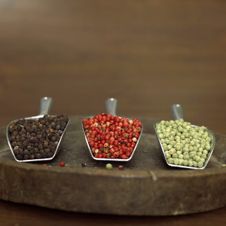 Red, green and black pepper on shovel - WESTF00830