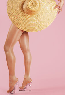 Woman holding straw hat - 00062LR-U