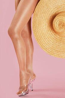 Woman holding straw hat - 00059LR-U