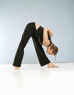 Woman doing yoga performing\
