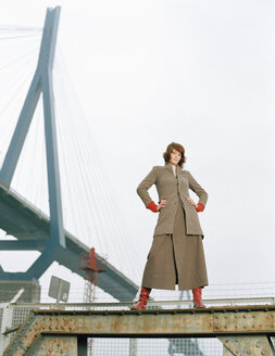 Woman standing on steel girder - DB00052