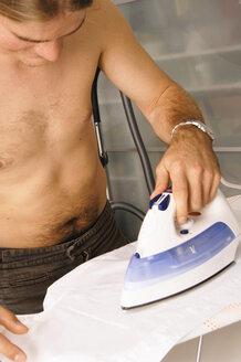 Man ironing shirt, close-up - 00144LR-U