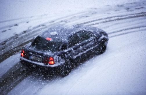 Car on snowy street - WWF00155