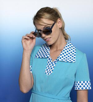 Woman with light blue dress and sunglasses, portrait - JL00196