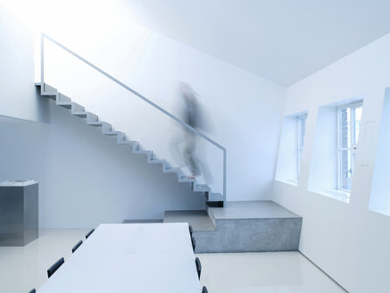 Person walking upstairs, side view - KM00482
