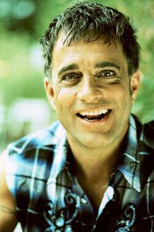 Mature man smiling, portrait - KM00302