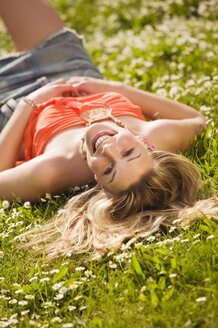 Young woman lying in meadow - KMF00228