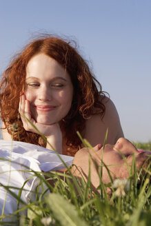 Young couple lying in meadow - LDF00252