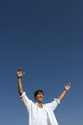 Young man, smiling, arms outstretched - LDF00204