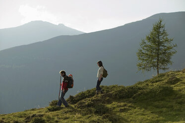 Young couple walking in mountains - BABF00199