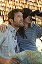 Young couple, woman holding binocular - BABF00136