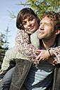 Young couple, woman embracing man - BABF00100