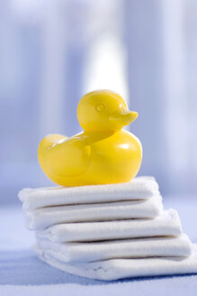 Rubber duck on top of stacked diapers - SMOF00055