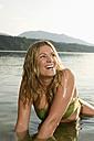 Woman bathing in lake - ABF00091