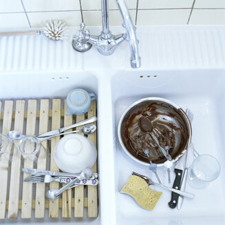 Used dishes in kitchen sink, elevated view - CO00105