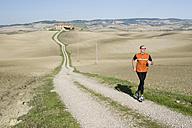 Italy, Tuscany, man jogging - MRF00731