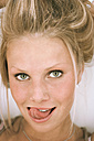 Young woman licking lips, close-up, portrait - MFF00279