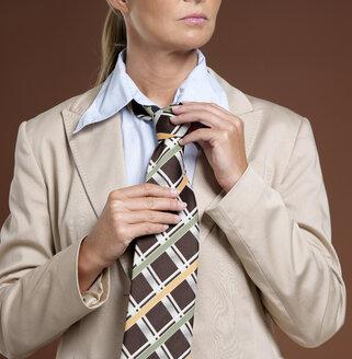 Businesswoman wearing suit and tie - JLF00251