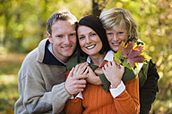 Parents with son (8-11) embracing, smiling, portrait, close-up - WESTF03096