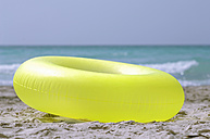 Inflatable ring in sand - ASF02781