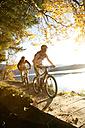 Germany, Bavaria, Couple mountain biking - MRF00802