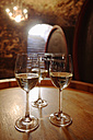 Wite wine in glasses on wine cask - WESTF03772