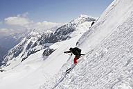 Austria, Tyrol, person telemark skiing - FFF00756
