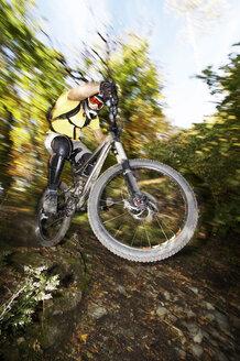 Germany, Bavaria, man performing jump on bicycle - FFF00719